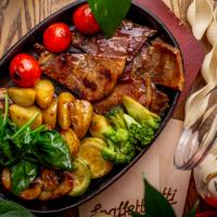 Язык запеченный с овощами и соусом BBQ